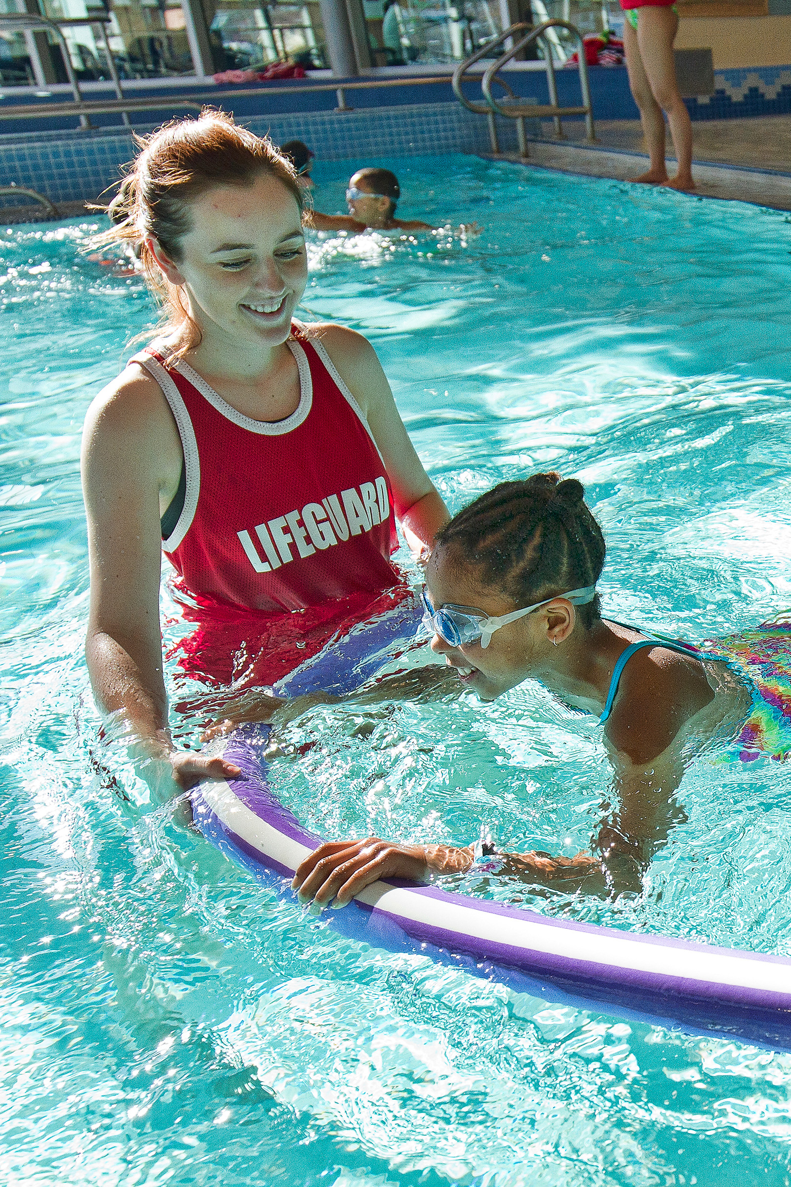 Image of lifeguard and young swimmer