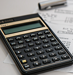 Image of a calculator and a finance document